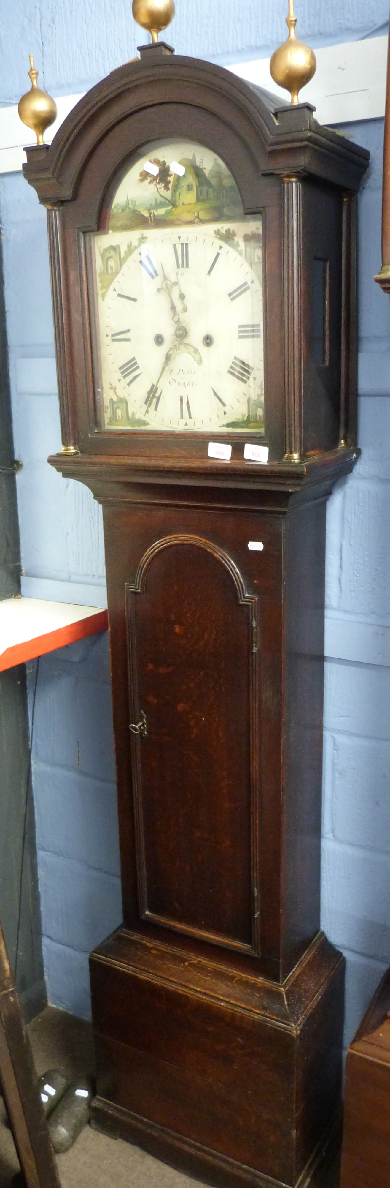 Oak longcase clock with hand painted face depicting various countryside scenes around Roman dial