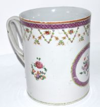 Late 18th century Chinese export porcelain tankard decorated in polychrome with trailing flowers