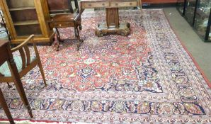 Large carpet, mainly on a red field, with blue floral motif, multi-gulled borders