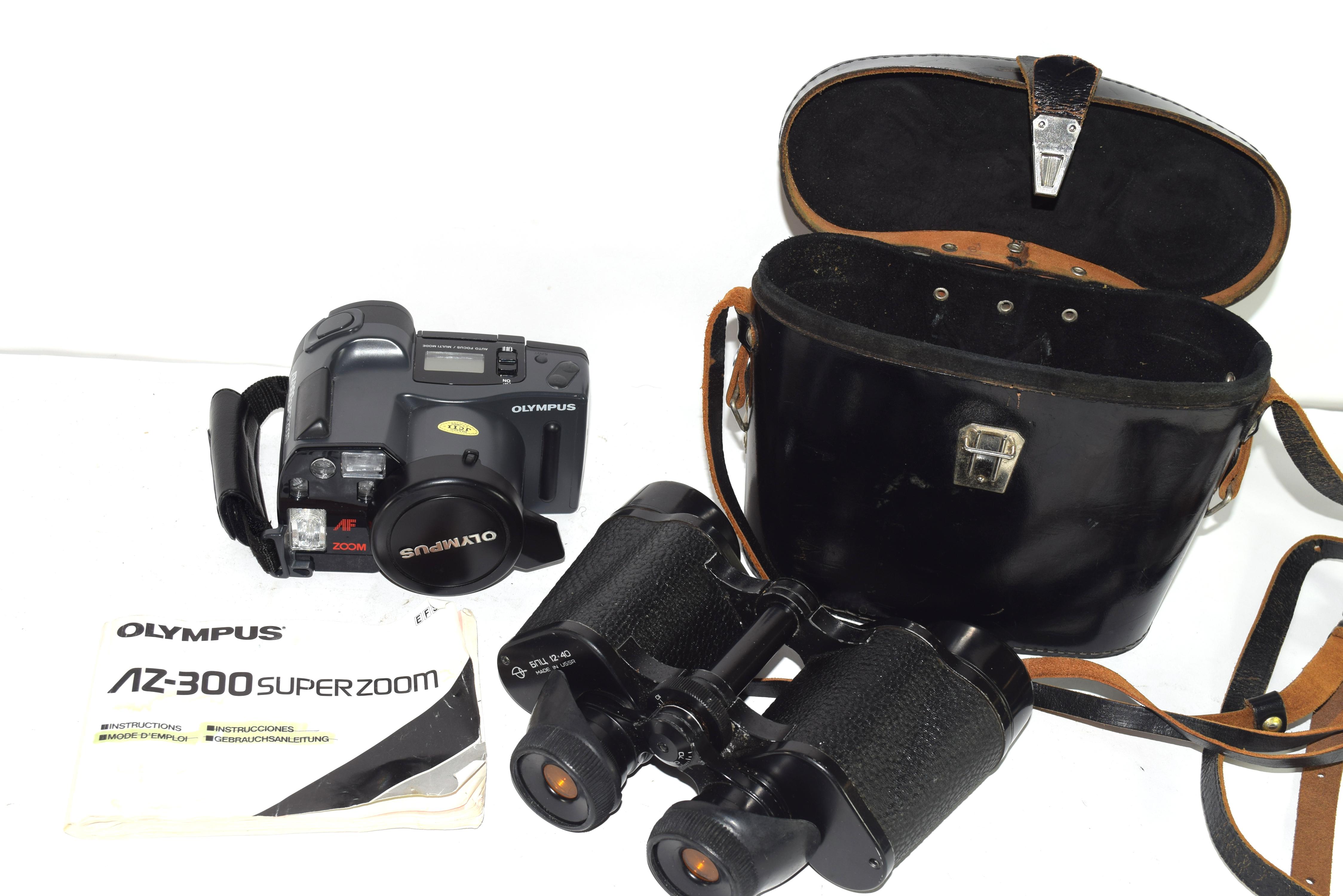 Binoculars in original black leather case and an Olympus camera (2) - Image 2 of 6