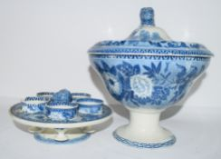 Early 19th century pearlware flow-blue egg cup stand and warmer, the interior with four egg cups and