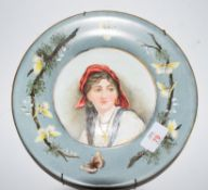 Victorian plate with a hand painted decoration of a young gipsy girl, signed verso