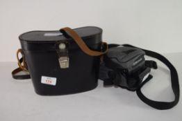 Binoculars in original black leather case and an Olympus camera (2)
