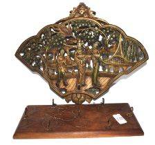 Carved Oriental coat rack together with a further carved wooden plaque with Oriental figures in a