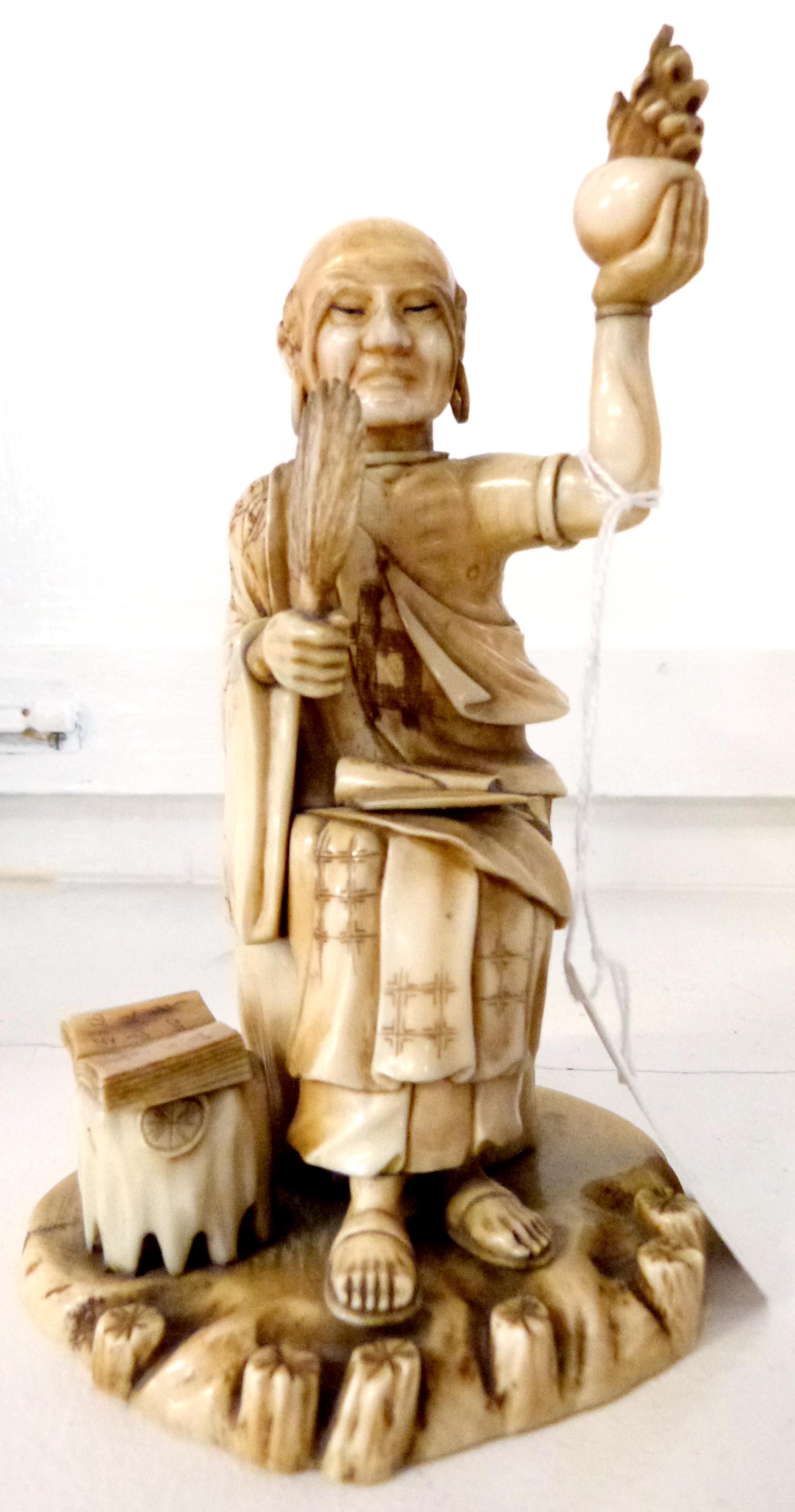 Ivory Okimono modelled as a priest, 15cm high