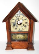 Clock in mahogany case, decorated to front with a military scene of cannon and crossed swords