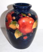 Moorcroft vase decorated in the pomegranate pattern, green WM signature to base