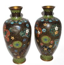 Pair of early 20th century cloisonne vases, of baluster shape, decorated in typical fashion, 17cm