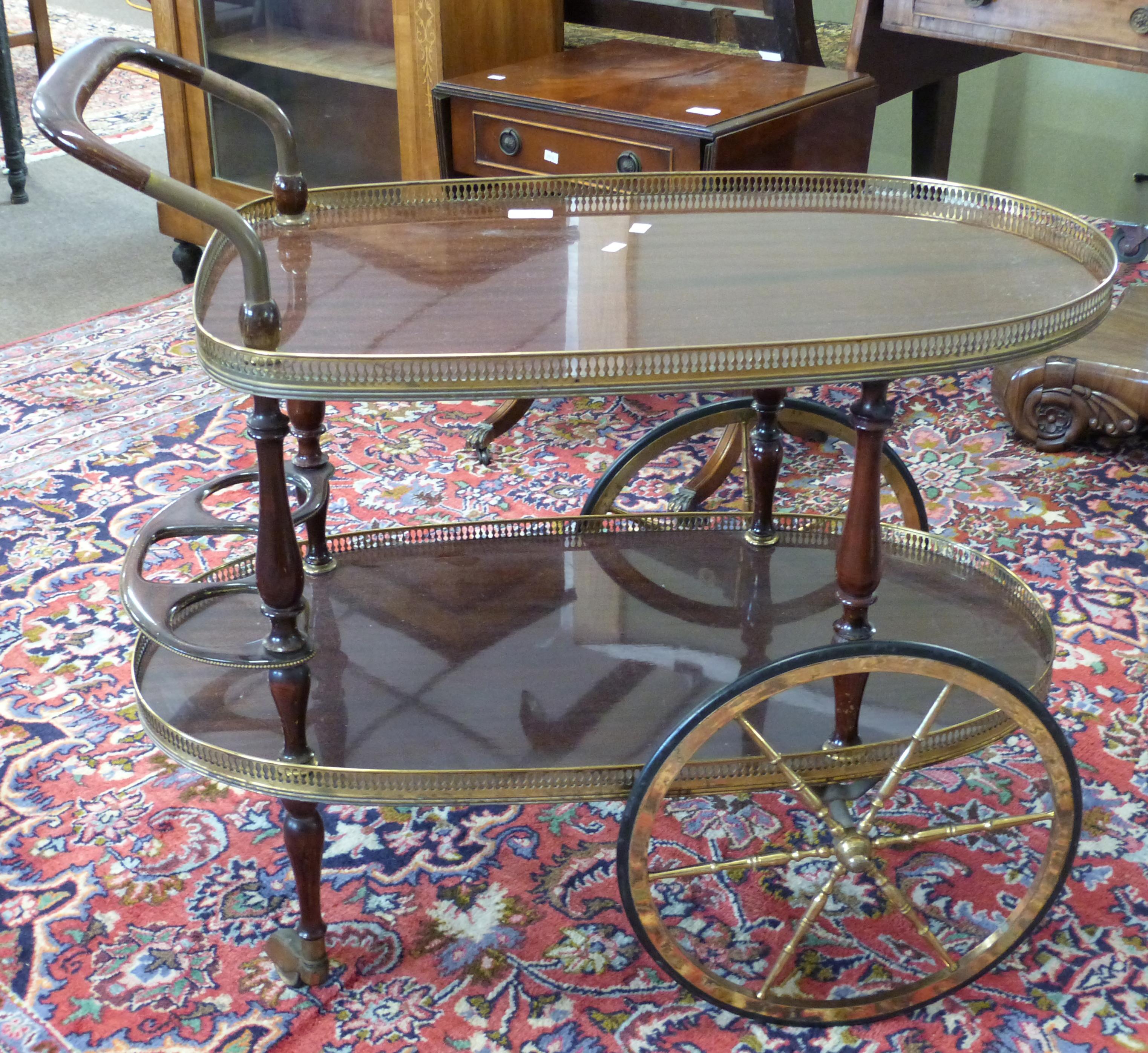 Mahogany effect and gilt decorative tea trolley, length approx 80cm