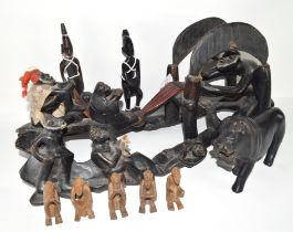 Tribal art interesting carving of a rowing machine with figures, probably West African, together