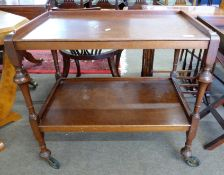Early 20th century tea trolley with turned legs, length approx 76cm