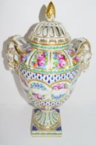 Large Continental porcelain vase with pierced decoration and floral swags and rams-head handles, the