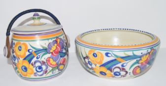 Poole Carter Stabler Adams biscuit barrel with floral design and wicker handle, together with a