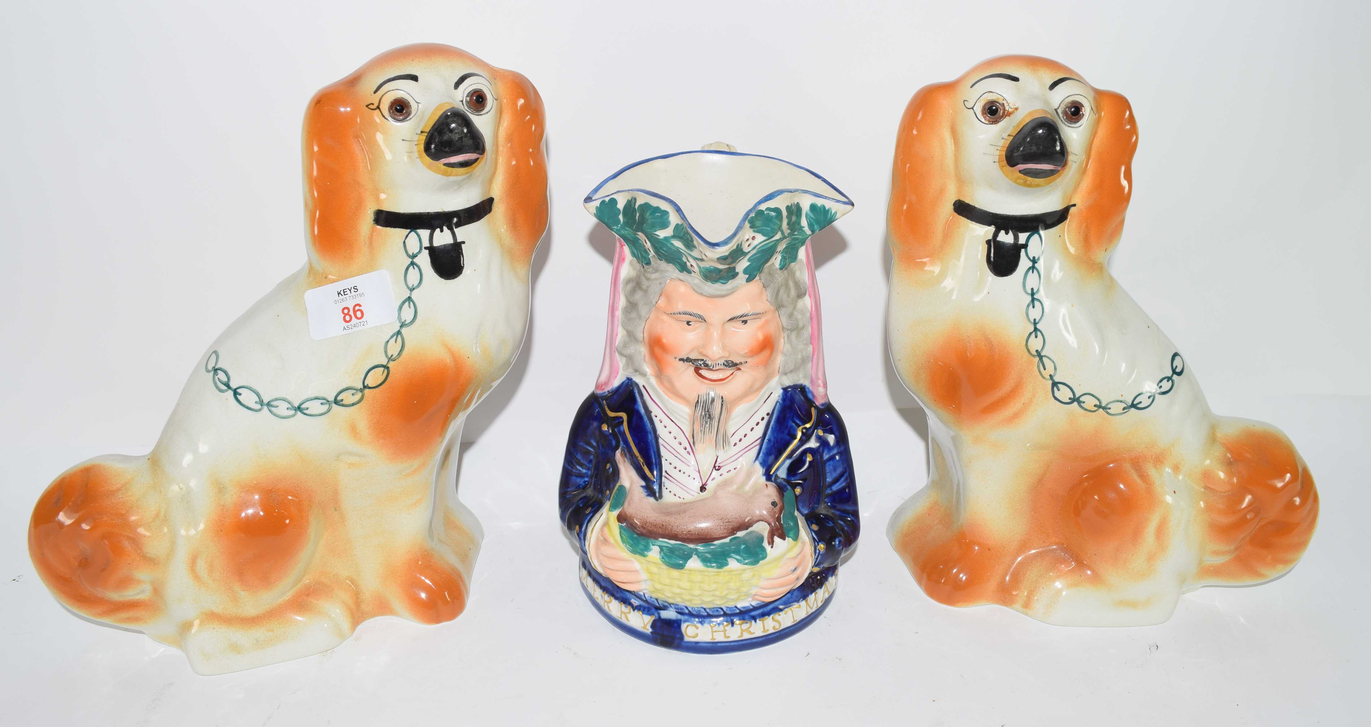 Two Staffordshire type dogs and further Staffordshire Toby jug (3)