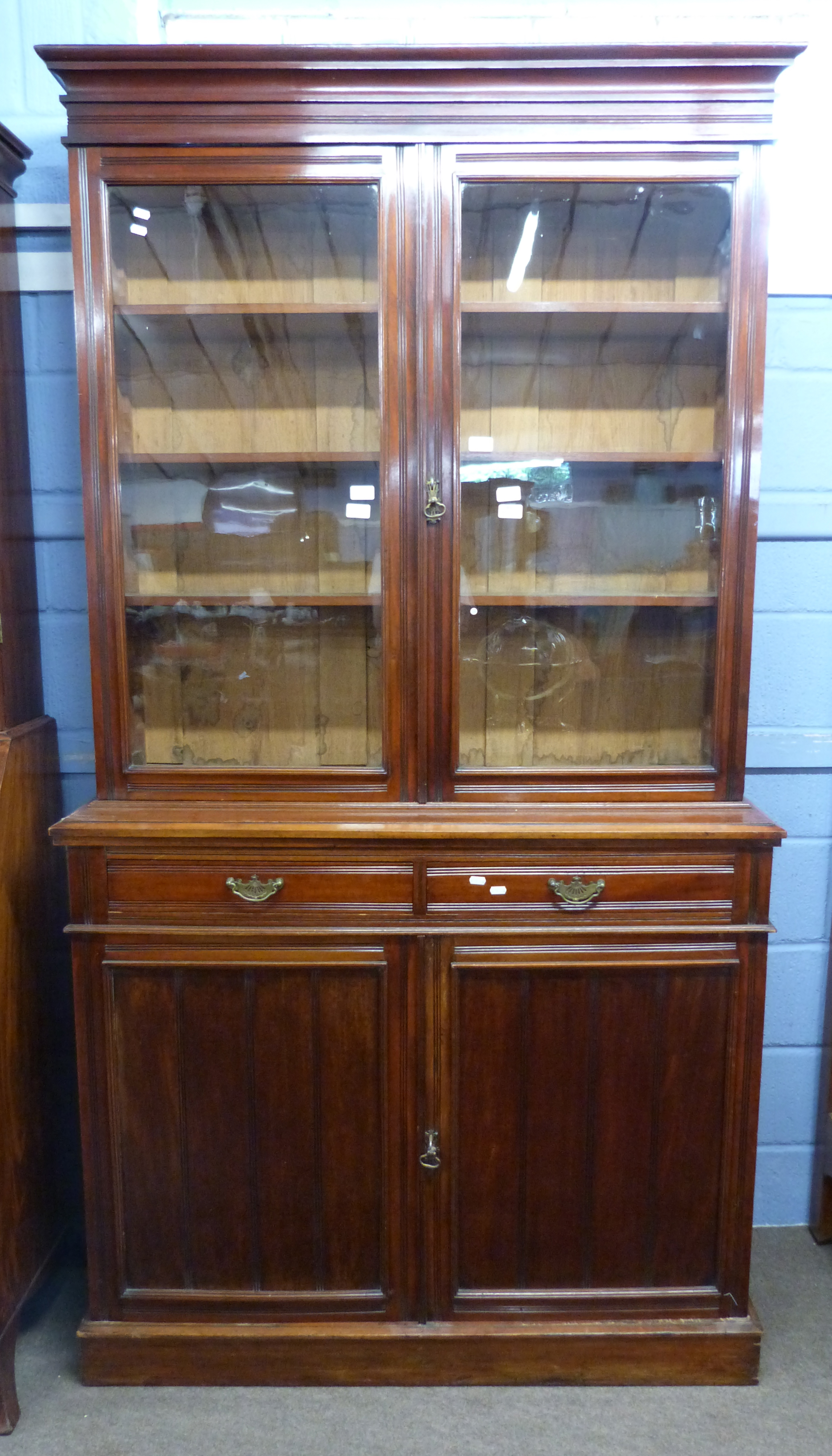 Full height mahogany side cabinet with glazed bookcase raised over double cupboard, width approx