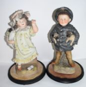 Pair of late 19th century Continental bisque figures of a boy and girl, possibly Russian, both