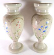 Pair of glass vases with an applied design of flowers in beaded reserves, 37cm high (2)