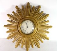 Eight day sunburst clock with typical metal design