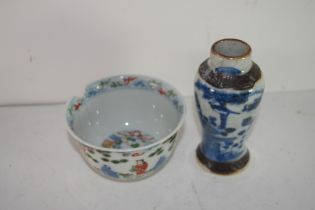 Small Chinese porcelain bowl decorated in Wucai fashion with Chinese figures in garden setting,