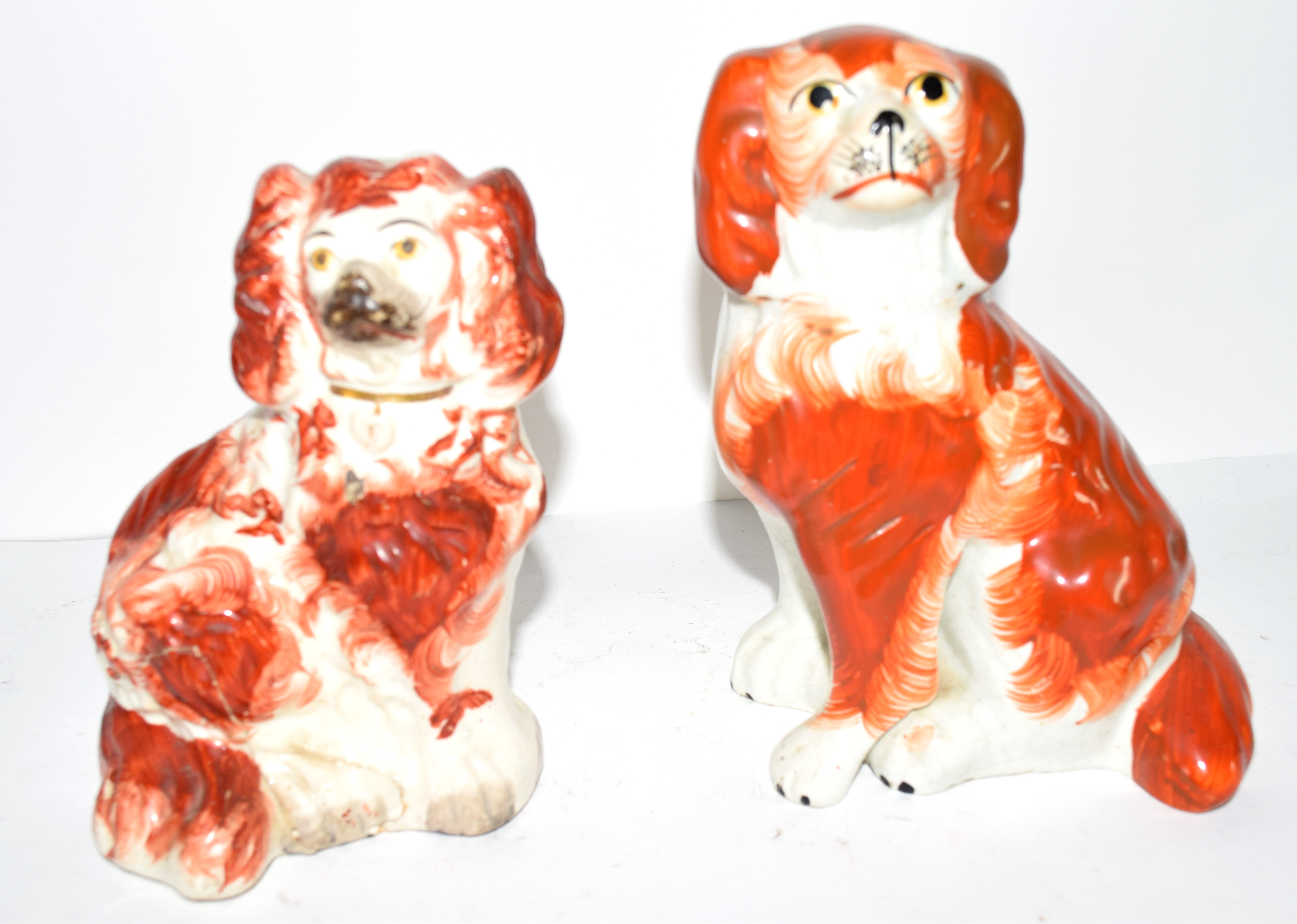 Two Staffordshire dogs with red decoration in typical fashion