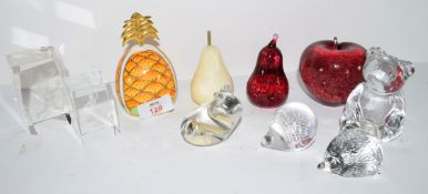 Quantity of paperweights and other items including a Royal Worcester model of a pineapple, glass