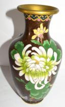 Cloisonne vase, the brown ground decorated with flowers in tones of green, 20cm high