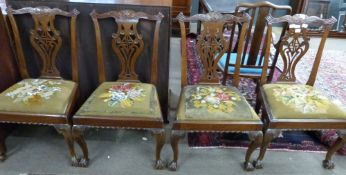 Set of 4 Chippendale style mahogany dining chairs, elaborate pierced splat backs, old tapestry