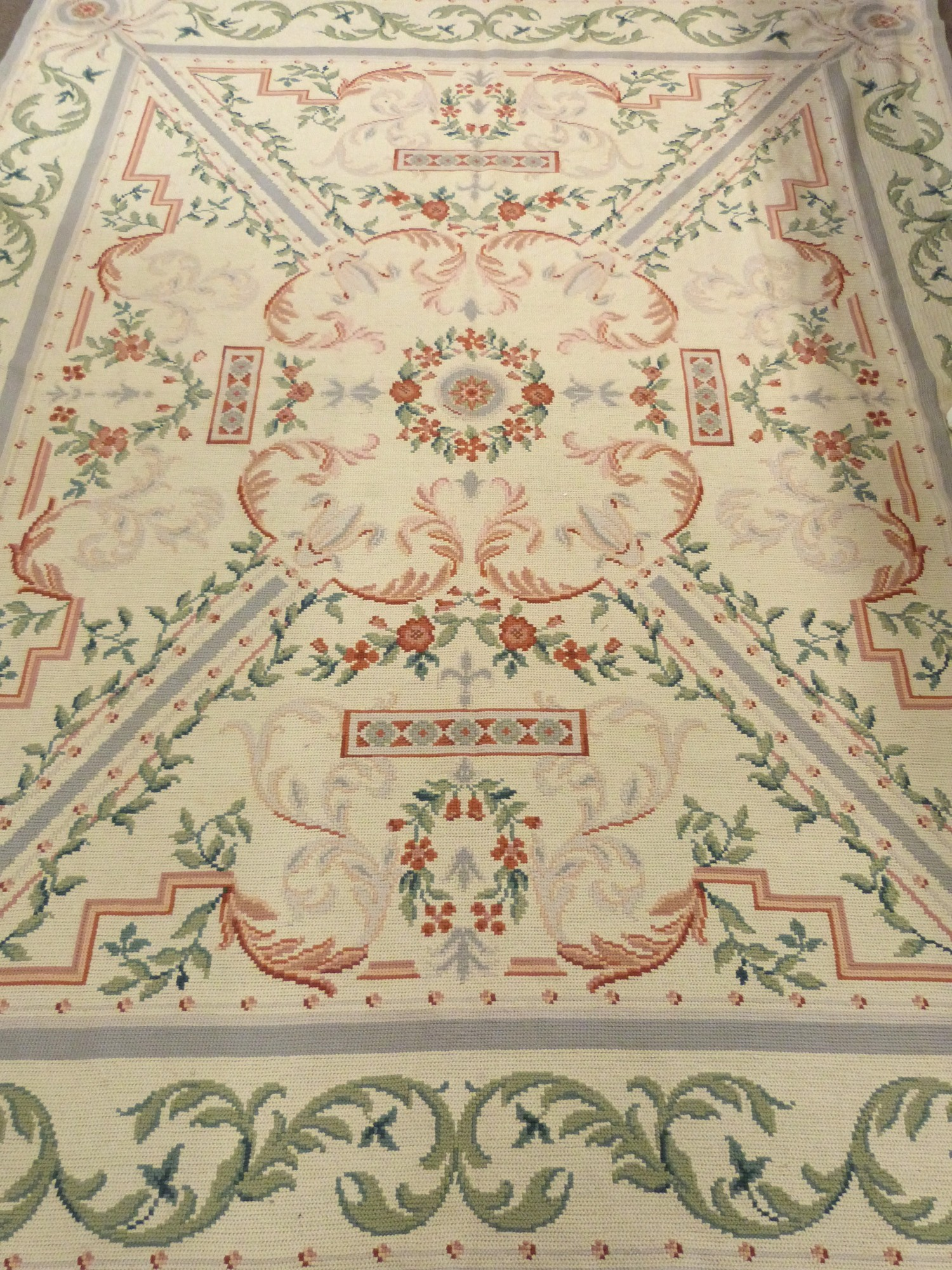 Woolwork carpet, cream ground, pink and green designs, green foliate scroll border 10 x 8ft - Image 2 of 3