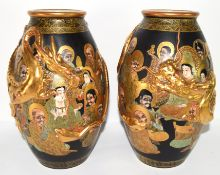 Pair of Satsuma vases, the black ground decorated with sages in gilt, together with dragons modelled