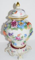 Continental porcelain vase and cover decorated in Meissen style with floral sprays with moulded