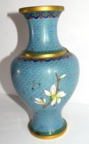 Cloisonne vase decorated in typical fashion with flowers on blue and gilt ground, 23cm high