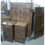 An early 20th century oak bedroom suite in the Arts & Crafts style comprising mirror back dressing