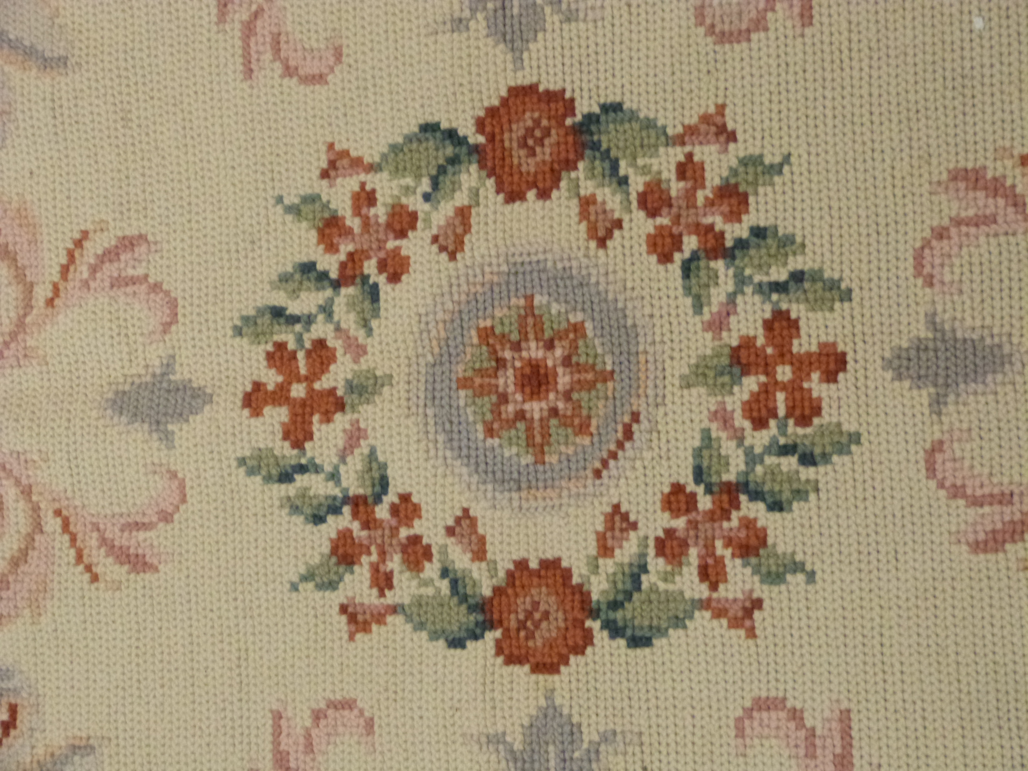 Woolwork carpet, cream ground, pink and green designs, green foliate scroll border 10 x 8ft - Image 3 of 3