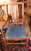 Mahogany armchair with strung decoration throughout, width approx 53cm max