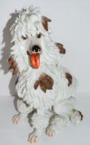 Algora porcelain model of an afghan hound modelled in Meissen style, 34cm high