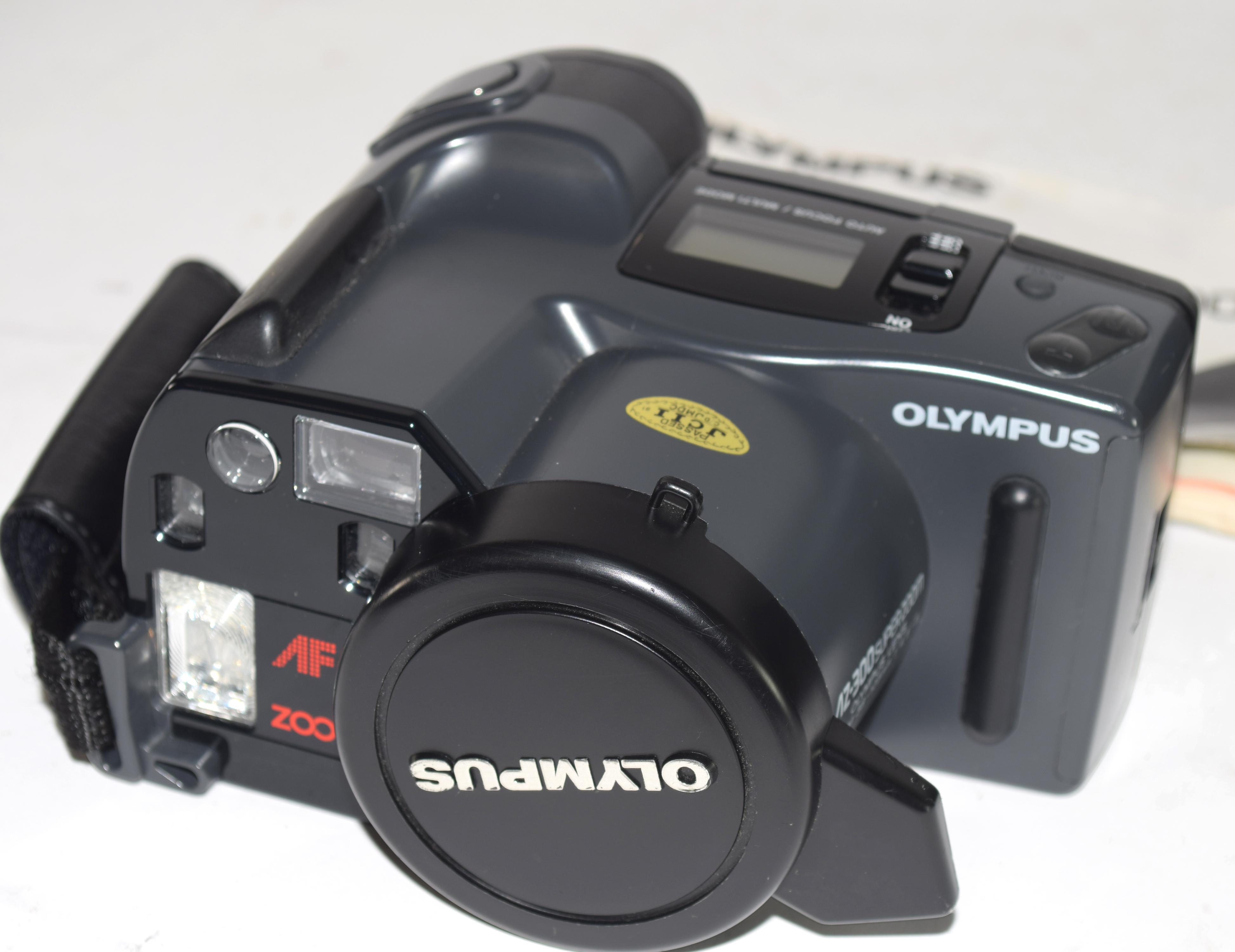 Binoculars in original black leather case and an Olympus camera (2) - Image 4 of 6