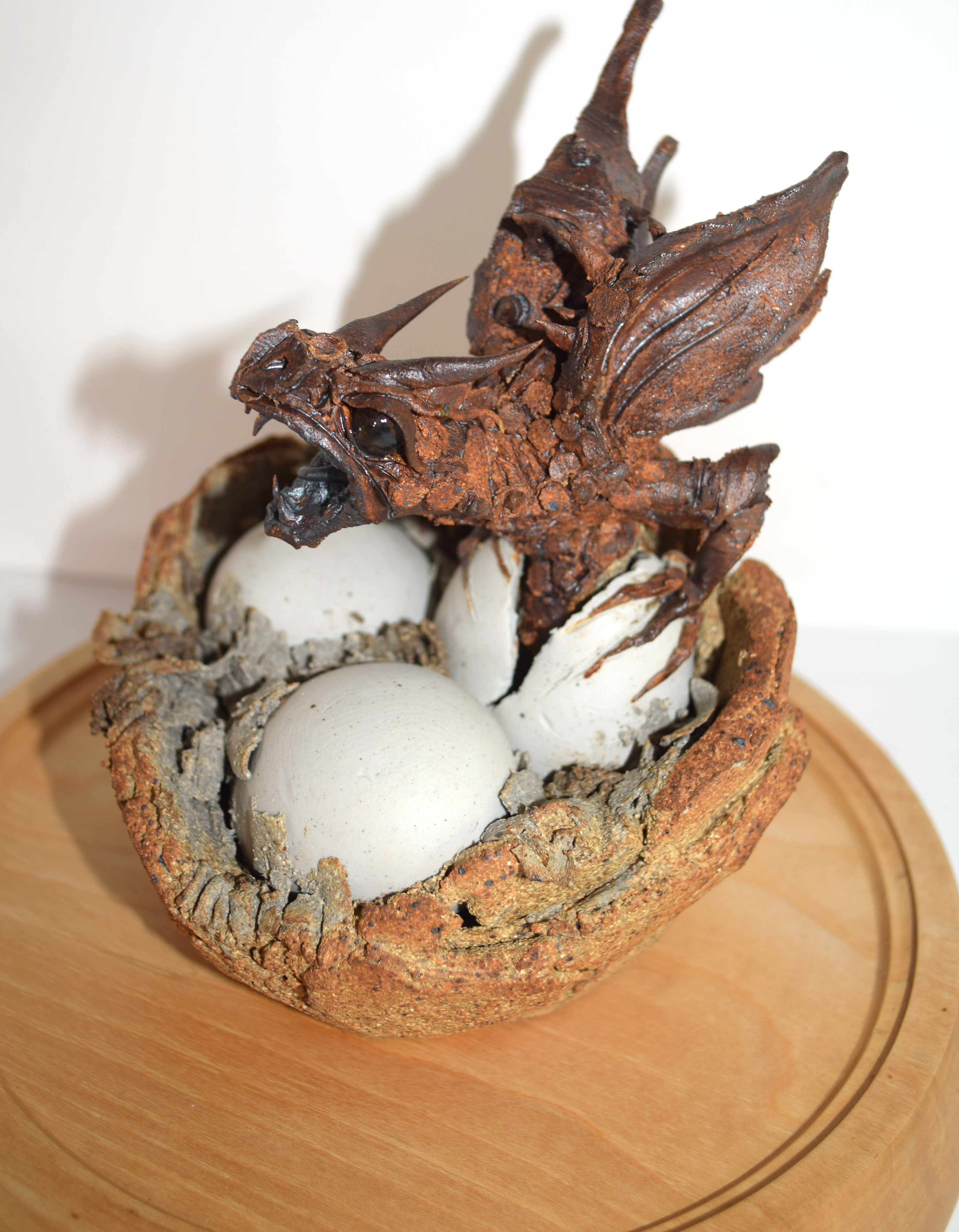 Ceramic sculpture of a baby dragon coming out of an egg, the sculpture under a glass dome, 36cm - Image 2 of 2