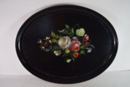 Papier mache type tray, the centre decorated with flowers and fruit within a loop border, 52cm long