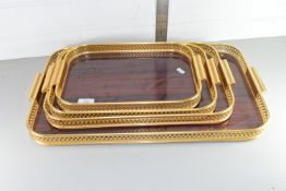 SET OF FOUR MATCHING BRASS TRAYS