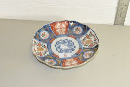 SMALL ORIENTAL HAND PAINTED PANELLED PLATE DEPICTING FLORA AND RABBITS
