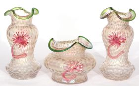 Three pieces of Loetz glass including pair of vases with shaped tops and a further bowl, all