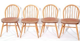 1960s Ercol rectangular dining table together with a set of four similar stick back chairs