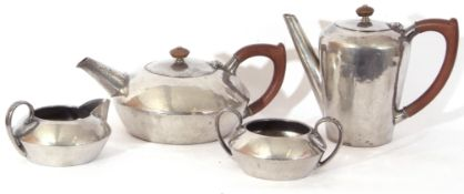 Pewter tea set manufactured in the Tudric style for Liberty & Co comprising tea pot, hot water