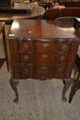 20TH CENTURY REPRODUCTION MAHOGANY SERPENTINE FRONT THREE DRAWER CHEST RAISED ON CABRIOLE LEGS, 61CM