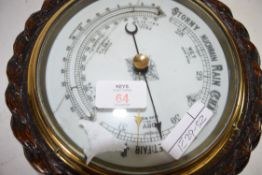 EARLY 20TH CENTURY ANEROID BAROMETER SET IN AN OAK ROPE FORMED CASE
