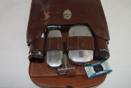 LEATHER BOX CONTAINING GENTS HAIR BRUSHES ETC