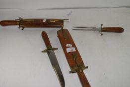 TWO WOOD CASED CARVING SETS WITH BRASS MOUNTS