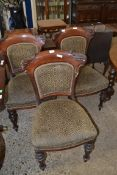 SET OF THREE VICTORIAN MAHOGANY DINING CHAIRS, WITH SHAPED BACKS, UPHOLSTERED IN GREEN FABRIC,