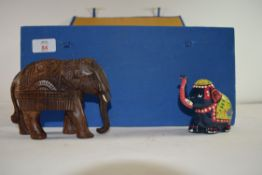 SMALL BOX CONTAINING VARIOUS BRASS, WOODEN AND COMPOSITION MODELS OF ELEPHANTS