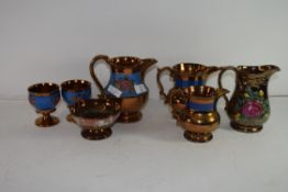 GROUP OF VICTORIAN COPPER LUSTRE GLAZED WARES COMPRISING FOUR JUGS, TWO GOBLETS AND A PEDESTAL BOWL